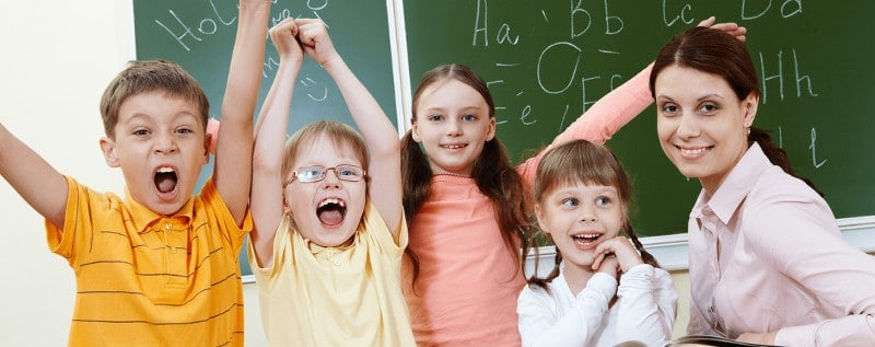 lively kids with teacher in the classroom