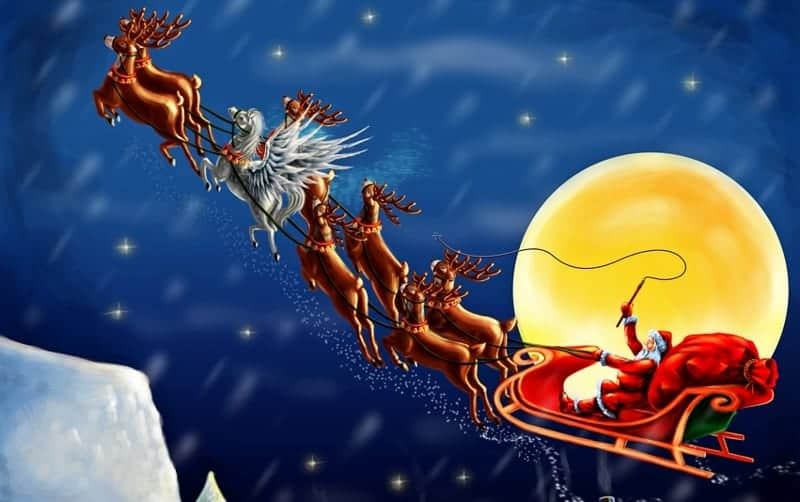 father christmas and reindeer flying over rooftops