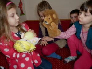 preschool ELLs playing with puppets