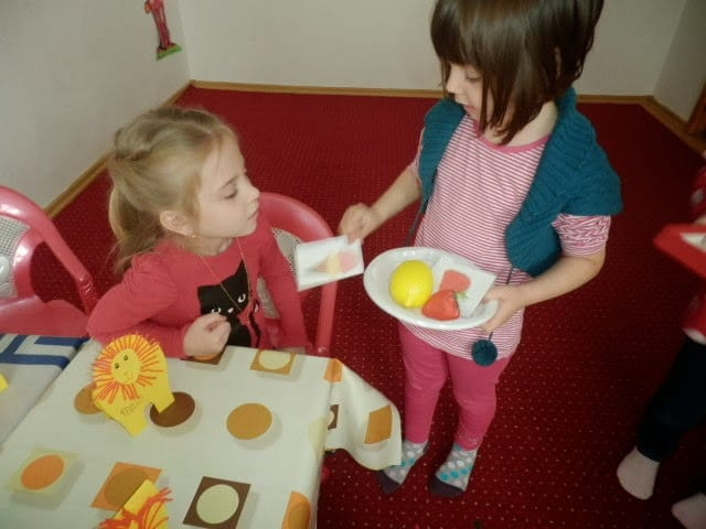 preschool children role-play with fruits