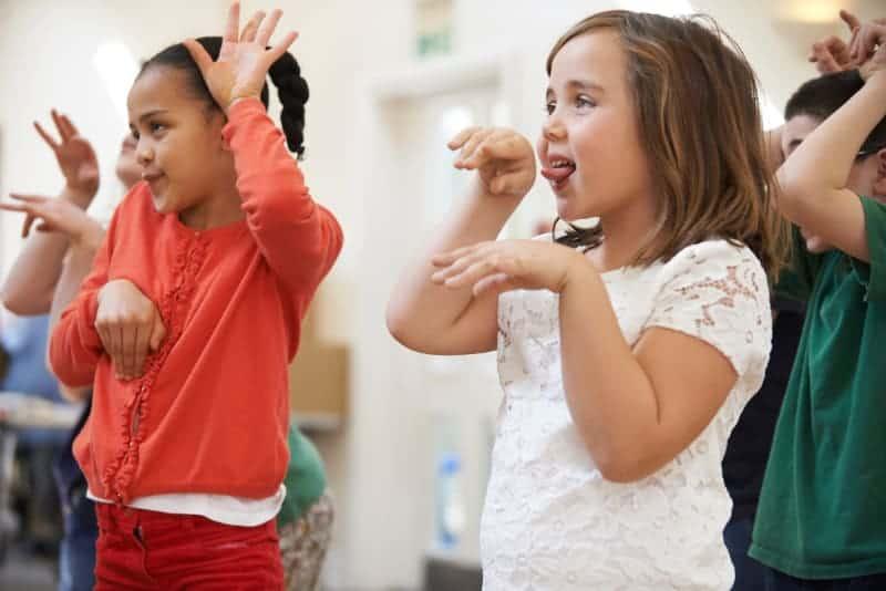 children miming being animals to music