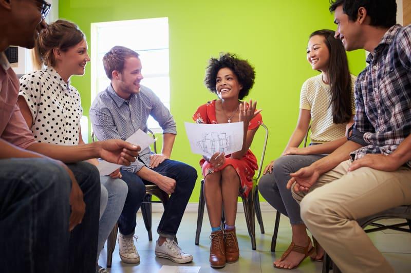 group of ESL students debating