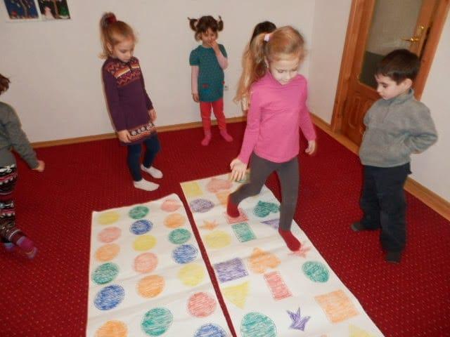 preschool children playing Twister