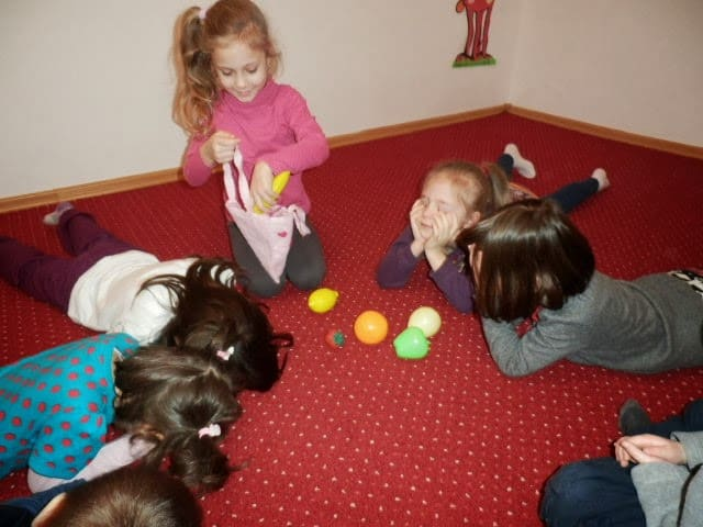 preschool kids playing a game with fruits